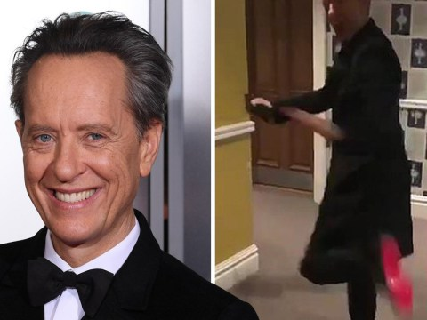 Richard E Grant dances like no one's watching as he attempts to show us his Louboutins ahead of Baftas