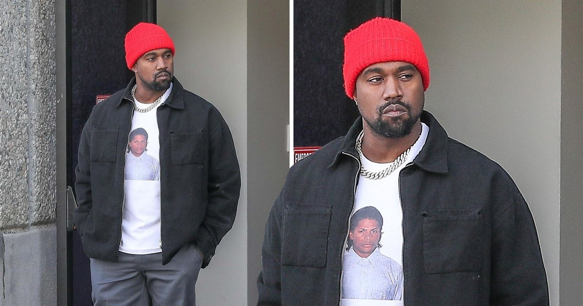 Kanye West looks absolutely thrilled to be working on the weekend as he steps out in Eazy E t-shirt