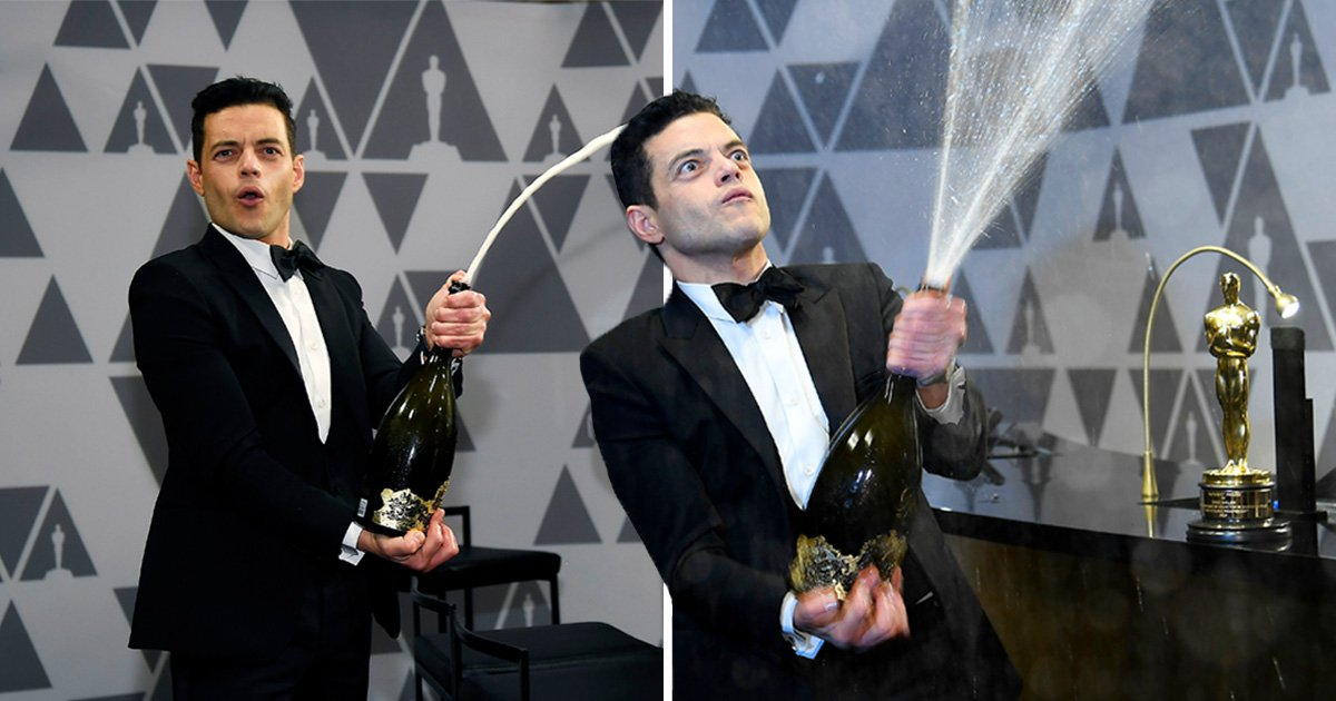 Oscar-winner Rami Malek celebrates with messy champagne shower as he sprays bottle over Governors Ball after-party