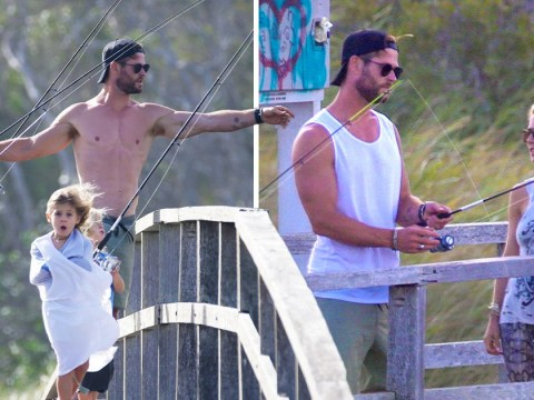 Chris Hemsworth proves why he is Thor-worthy as he goes shirtless on family fishing trip in Byron Bay