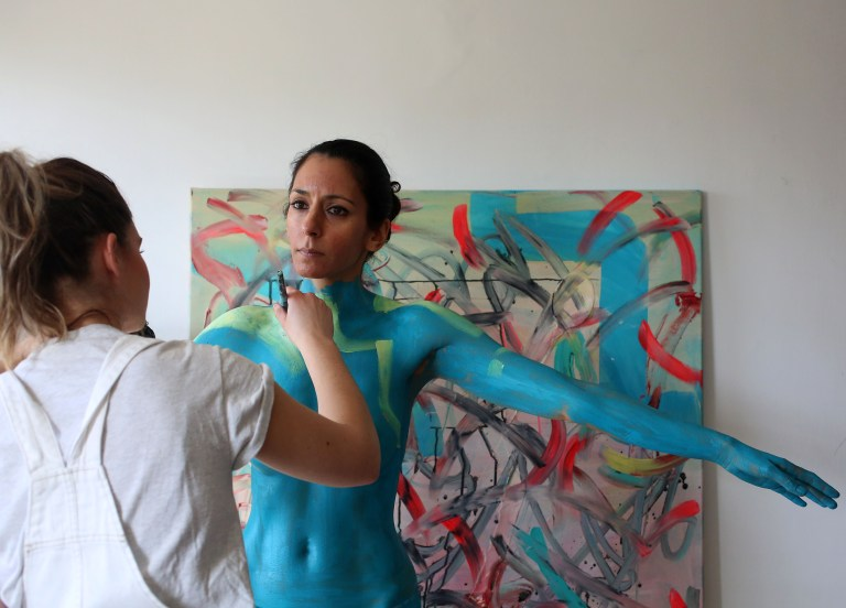 Artist Anne-Claire Fleer paints a model