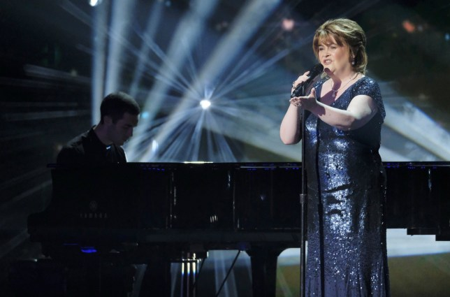 susan boyle singing on stage at america's got talent the champions