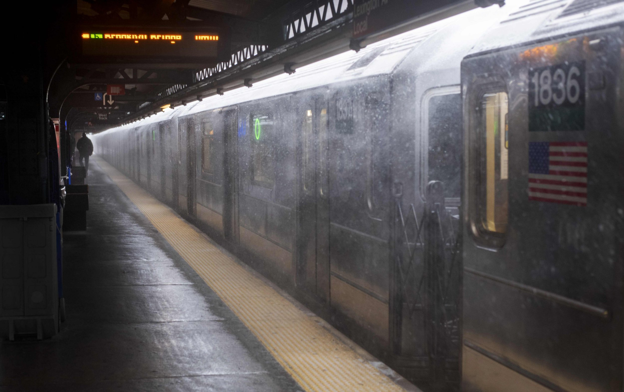 A man walks next to a subway train as heavy snow falls on January 30, 2019 in New York. - The polar vortex that hit the Midwest has moved to the east bringing high winds and freezing temperatures. (Photo by Don EMMERT / AFP)DON EMMERT/AFP/Getty Images