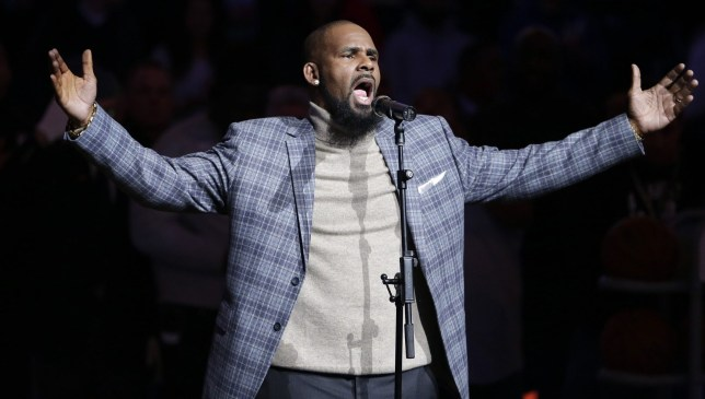 FILE - In this Nov. 17, 2015, file photo, musical artist R. Kelly performs the national anthem before an NBA basketball game between the Brooklyn Nets and the Atlanta Hawks in New York. For Grammy-nominated singer Joe, singing the hit song R. Kelly wrote and produced for him is out of the question. ???I???ve stopped performing the song,??? he said in a statement to The Associated Press, referring to ???More & More,??? a Top 20 R&B success released in 2003. ???No music or intellectual property is worth being inconsiderate to the feelings or pain of others,??? 45-year-old Joe continued. (AP Photo/Frank Franklin II, File)