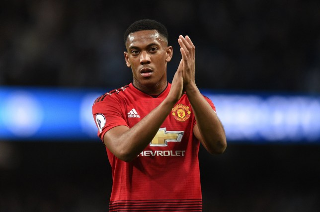 (FILES) In this file photo taken on November 11, 2018 Manchester United's French striker Anthony Martial applauds fans after losing the English Premier League football match between Manchester City and Manchester United at the Etihad Stadium in Manchester, north west England. - Anthony Martial has signed a new contract that will keep him at Manchester United until June 2024 just months after he seemed set to leave, the Premier League club announced on Thursday, January 31, 2019. (Photo by Oli SCARFF / AFP) / RESTRICTED TO EDITORIAL USE. No use with unauthorized audio, video, data, fixture lists, club/league logos or 'live' services. Online in-match use limited to 120 images. An additional 40 images may be used in extra time. No video emulation. Social media in-match use limited to 120 images. An additional 40 images may be used in extra time. No use in betting publications, games or single club/league/player publications. / OLI SCARFF/AFP/Getty Images