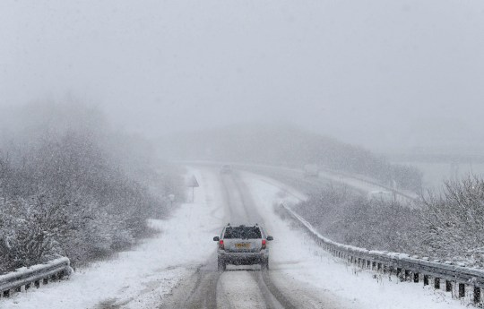 A car driving in the February 2019 snow conditions in south-west England
