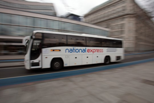 A National Express Group Plc coach is driven through London, U.K., on Wednesday, Feb. 22, 2012. The Confederation of British Industry urged Chancellor of the Exchequer George Osborne to make life easier for companies so that they can generate growth and employment. Photographer: Simon Dawson/Bloomberg via Getty Images