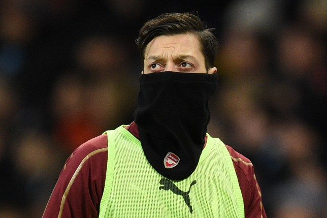 Arsenal's German midfielder Mesut Ozil warms up ahead of the English Premier League football match between Manchester City and Arsenal at the Etihad Stadium in Manchester, north west England, on February 3, 2019. (Photo by Oli SCARFF / AFP) / RESTRICTED TO EDITORIAL USE. No use with unauthorized audio, video, data, fixture lists, club/league logos or 'live' services. Online in-match use limited to 120 images. An additional 40 images may be used in extra time. No video emulation. Social media in-match use limited to 120 images. An additional 40 images may be used in extra time. No use in betting publications, games or single club/league/player publications. / OLI SCARFF/AFP/Getty Images
