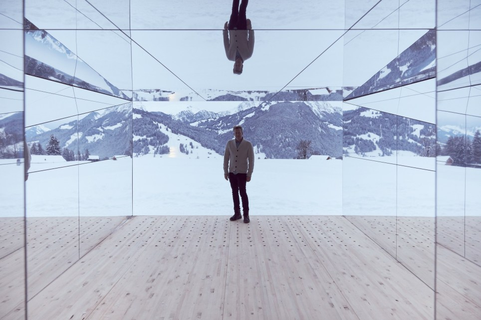 "American artist Doug Aitken has installed a ranch-style house clad in mirrors in the snow-covered mountains of Gstaad, Switzerland. The single-storey Mirage structure uses the frequency of light to reflect the sublime Alpine landscape as part of a continually changing encounter in which land and sky, subject and object, inside and outside are in constant flux. With every available surface clad in mirror it both absorbs and reflects the landscape around in such ways that the exterior will seemingly disappear just as the interior draws the viewer into a neverending kaleidoscope of light and reflection. The installation forms part of Frequencies, a site-specific set of art performances that run from 1 to 3 February 2019 in Gstaad, curated by Neville Wakefield and Olympia Scarry. Aitken's structure is set to remain in its mountain location for two years. Visitors can freely explore the mirrored structure, which has an open door. ""The viewer can come back to the piece as the seasons are changing, in fall in a storm or in the summer when it's a green pasture. As our lives change the artwork is shifting with us."" The structure is modeled on the Californian ranch houses developed in the 1920s and 1930s that incorporated the ideas of modernist architect Frank Lloyd Wright with the traditional ranch houses of the American West. Aitken has previously installed Mirage in the desert outside Palm Springs in 2017 and inside a former state bank in Detroit last year. Featuring: Doug Aitken Where: Gstaad, Switzerland When: 04 Feb 2019 Credit: Elevation 1049: Frequencies/Cover Images **All usages and enquiries, please contact info@cover-images.com - +44 (0)20 3397 3000EDITORIAL USE ONLY. MATERIALS ONLY TO BE USED IN CONJUNCTION WITH EDITORIAL STORY. THE USE OF THESE MATERIALS FOR ADVERTISING, MARKETING OR ANY OTHER COMMERCIAL PURPOSE IS PROHIBITED. COVER IMAGES DOES NOT CLAIM ANY OWNERSHIP OF THE MATERIALS. MATERIAL COPYRIGHT REMAINS WITH THE PHOTOGRAPHER.**"