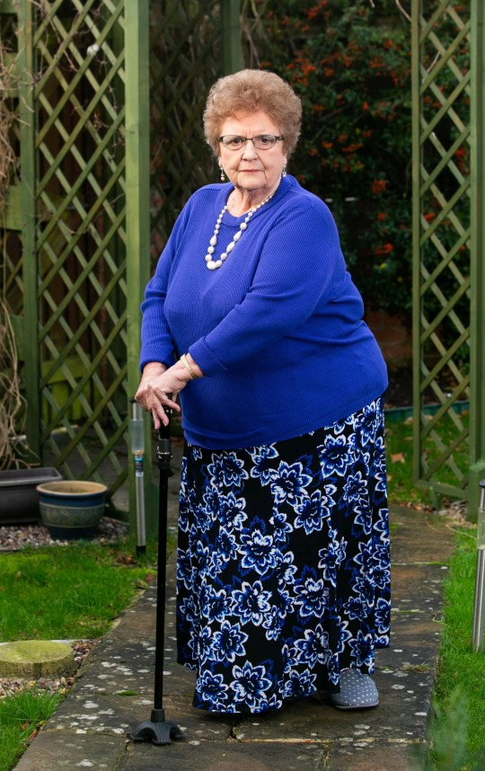 """Carol Bishop, 73 from Mudford, Somerset, is annoyed because doctors have refused to give her a hip replacement until she loses 3 stone. See SWNS story SWTPhip.A 17st grandmother has accused the NHS of """"fat discrimination"""" after being refused a hip operation - unless she loses weight.Carol Bishop, 73, suffers with arthritis and was referred to hospital in July for a hip replacement after suffering with pain on her left side.But she claims medics told her she had to lose three stone before she could have an op because of the increased risk that comes with operating on overweight patients.Grandmother-of-three Carol said she's too old to lose such a huge amount of weight - and she's quite happy the way she is."""