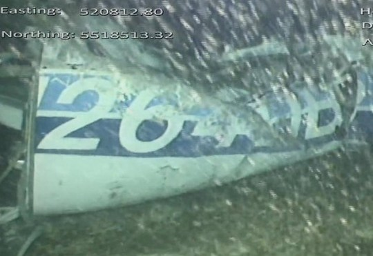AAIB photo showing the found aircraft tail of N264DB. See SWNS story SWPLplane - Latest on hunt for missing footballer Emiliano Sala after wreckage from his plane is found. A recovery operation is likely to begin tomorrow (Tues) if the wreckage of Emiliano Sala's plane is visually identified later today, rescuers have confirmed. The aircraft carrying the Cardiff City footballer was discovered 'almost intact' in the English Channel on Sunday following a privately-funded search. The Piper Malibu N264DB was initially lost on 21 January on its way from Nantes, France, to Cardiff, with the Argentine striker and pilot David Ibbotson on board. Accident investigators are expected to send a submersible to inspect the wreckage later on today (Monday) and look at the best way to retrieve it. However, any actual attempt to recover the plane is likely to not start until tomorrow morning (Tues) due to the rough and windy weather conditions around the Channel Islands.