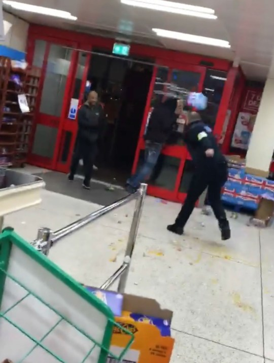 ASTONISHING footage shows an Iceland security guard get into a violent food fight with a customer. Bottles of water, eggs and broccoli are among the items thrown across the store during the bizarre altercation. It is not known what kicked off the amazing scenes but the customer appears to start by throwing food at the security man escorting him from the store in High Road, Ilford, London. Louis Hakes, 21, from Manchester, filmed the incident at the end of which the security man appears to lunge at his opponent with an object in his right hand. The apprentice rail engineer filmed the mayhem last night and posted the video to social media with the caption: ?When you go Iceland for a change and nearly end up in a food fight.?