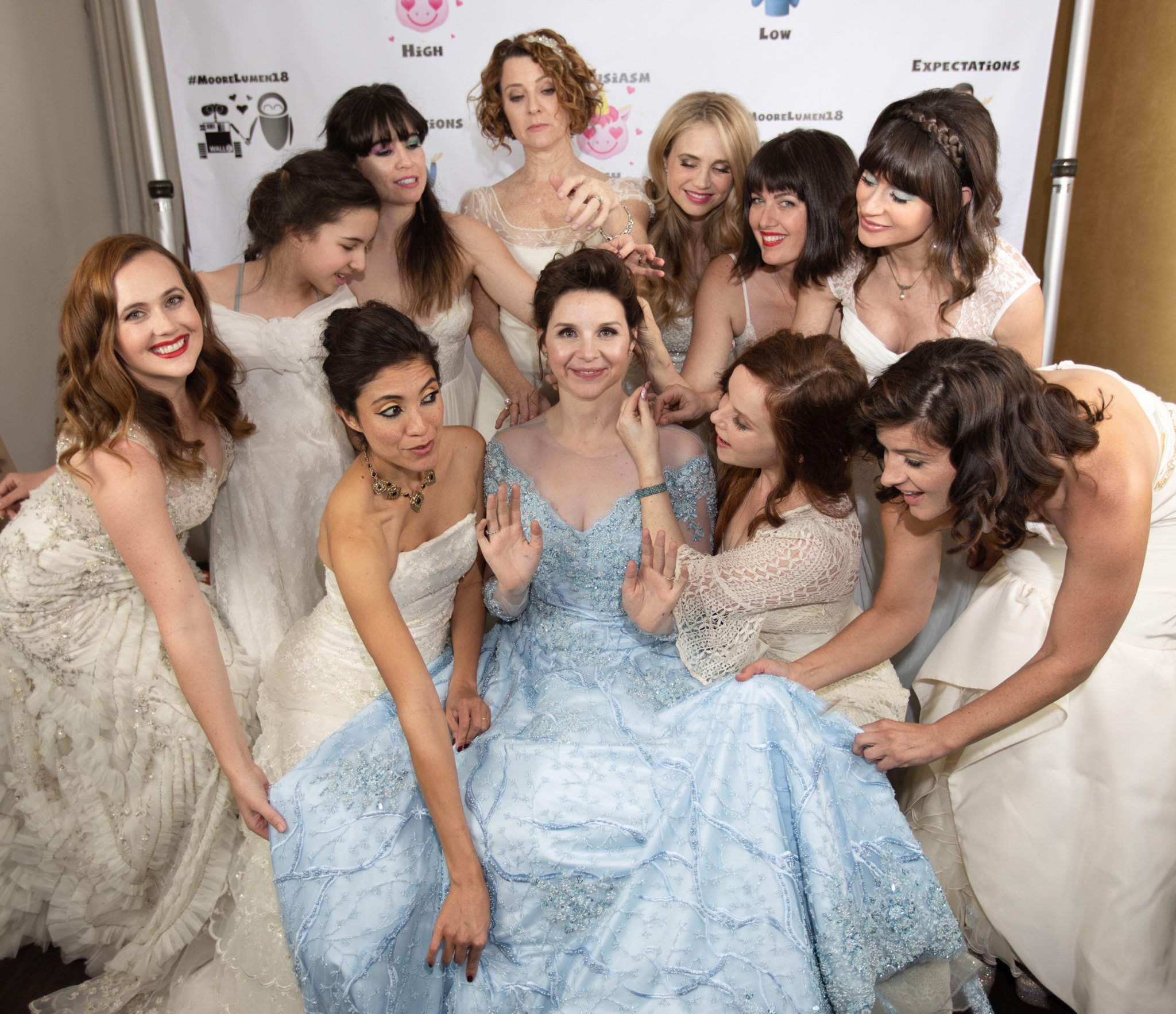 A newly married couple's 'non-traditional' dress code for their wedding day required female guests to wear their old bridal gowns. Newlyweds Audrey Moore and Jesse Luman, who live in Los Angeles, California, wanted their guests to have the opportunity to re-wear their old wedding dresses - something most people only get to wear once.