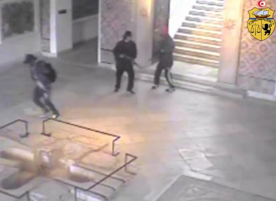 (FILES) This file photo released on March 22, 2015 shows an image grab taken from a closed circuit television footage released by the Tunisian interior ministry on its Facebook page on March 21, 2015 reportedly shows the two gunmen (R) who attacked Tunisia's National Bardo Museum holding their guns in a room as a man (L) runs out of the museum. - A Tunisian court was poised to give verdicts on February 8, 2019, in the trials of suspects in deadly jihadist attacks on the capital's Bardo museum and on a beach in the tourist resort of Sousse, lawyers told AFP. The court first reopened the trial into the March 18, 2015 attack by two assailants armed with Kalashnikov rifles on the Bardo that killed 21 foreign tourists and a Tunisian security guard. (Photo by - / INTERIOR MINISTRY / AFP)-/AFP/Getty Images