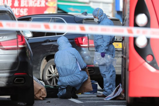 ?? Licensed to London News Pictures. 09/02/2019. London, UK. Forensics officers at a crime scene on the junction of Lewisham Road and Blackheath Hill in southeast London where a man was shot by police. Photo credit: Rob Pinney/LNP