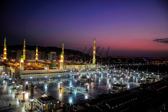 MEDINA, SAUDI ARABIA - AUGUST 25: General view of Masjid al-Nabawi, the mosque where hosts Holy Prophet Muhammad's tomb on the fourth day of Eid Al-Adha (Feast of Sacrifice), during Muslim pilgrims' visit after they completed the hajj pilgrimage in Medina, Saudi Arabia on August 25, 2018. Muslims worldwide celebrate Eid Al-Adha, to commemorate the holy Prophet Ibrahim?'s (Prophet Abraham) readiness to sacrifice his son as a sign of his obedience to God, during which they sacrifice permissible animals, generally goats, sheep, and cows. Eid-al Adha is the one of two most important holidays in the Islamic calendar, with prayers and the ritual sacrifice of animals. (Photo by Mustafa Ciftci/Anadolu Agency/Getty Images)