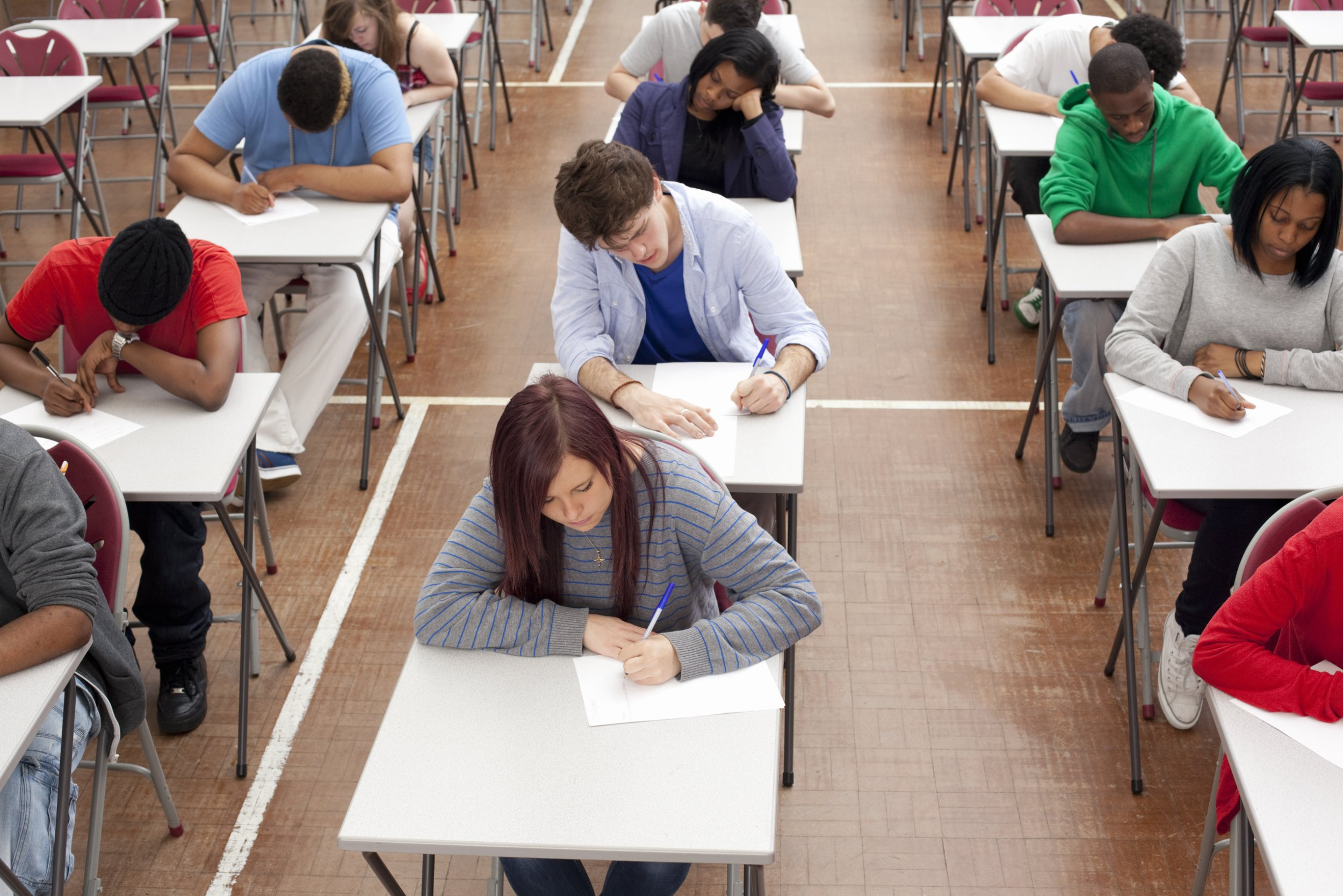 students in an exam hall in a further education college