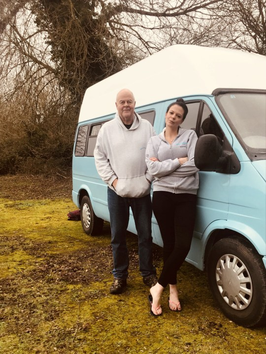 """Millie Corke, co-founder Katrina Clarke-Abbott with Nick Corke and the van given to the charity which turned out to be a rustbucket on wheels. See SWNS copy SWCAvan: A charity worker has blown a gasket after discovering a van donated to her by an 'undercover millionaire' on a TV show was a barely road-worthy """"rust bucket"""". Millie Corke, 32, was delighted when Channel 5 show Do the Right Thing presented the vehicle to her organisation Worry Tree Cafe. The mental health group had intended to use it as a 'Worry Wagon' to visit vulnerable people needing support in rural areas."""