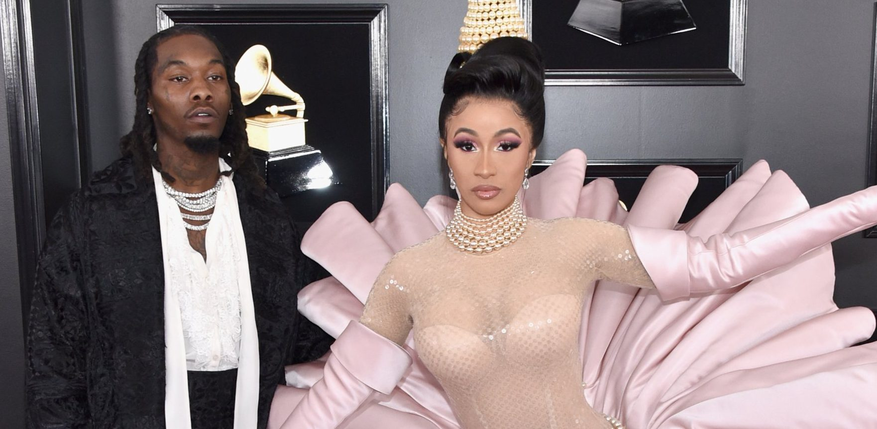 Cardi B struggles to walk on the Grammys 2019 red carpet in extra AF clam dress