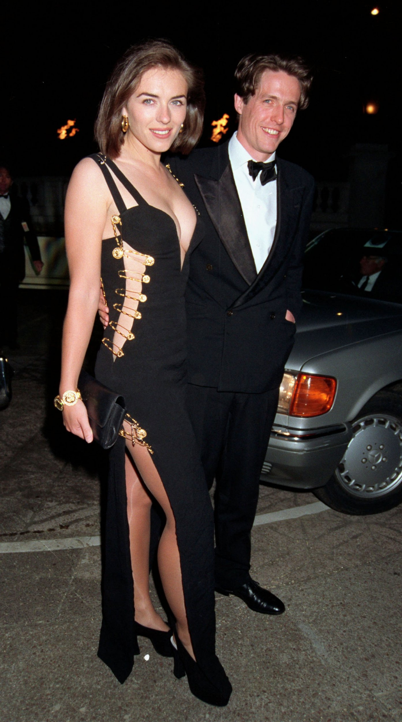 LONDON - MARCH 09: Actress Elizabeth Hurley wears a Giani Versace dress to the premiere of 'Four Weddings and A Funeral' held in Leicester Square on March 09, 1994 in London, England. (Photo by Dave Benett/Getty Images)