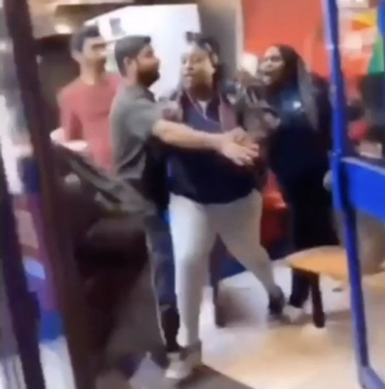 A confrontation between one woman, left, and three other woman breaks out in Carolina Pizza, Hackney, Saturday 9th February, 2019. THIS is the moment a vicious brawl breaks out between FOUR WOMEN in a takeaway pizza shop in London. In the footage, stunned onlookers scream in horror as three young women start wrestling and punching a lone female in the fast food restaurant. Then one of the young women violently throws the female to the floor and mercilessly beats her up. Staff can be seen desperately try to break the fight up as the woman repeatedly punches the female in the head. The astonishing fight took place in Carolina Pizza in Hackney, East London on Saturday evening. ... SEE COPY AND VID ... PIC BY NEWS DOG MEDIA ... 0121 517 0019