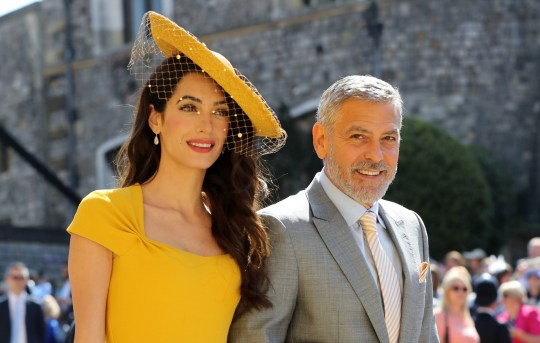 Amal Clooney and George Clooney arrive at St George's Chapel at Windsor Castle for the royal wedding of Meghan Markle and Prince Harry.