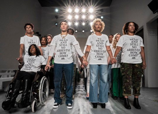 Jeff Moore 14/02/2019 72 ''models', comprised of activists, bereaved families, members of the community and high profile supporters of the cause [including Emelie Sande and Adwoa Aboah], united at the start of London Fashion Week yesterday, representing the 72 who lost their lives in the tragedy. Wearing a protest t-shirt designed by two young members from the Grenfell community, the 72 ???models,???, lined up on the catwalk of LFW at 180 The Strand calling for justice as nearly 2 years on from the tragedy of the Grenfell Tower fire, nobody has been held accountable. There are still hundreds of towers with flammable cladding, not all families have been adequately rehoused, developers are ???consistently ignoring??? the London Fire Brigade???s advice that sprinklers are crucial in their buildings and the second half of the inquiry has been delayed, probably until 2020. In short, there has been no justice, and lessons have not been learned.