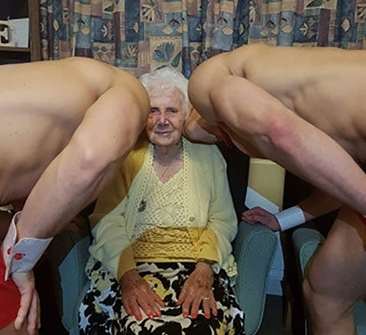 Doll Jenkins, 100 celebrating her 100th birthday in style with half naked hunks at Milton Lodge in Colchester, Essex. See SWNS copy SWCAhunks: A great-great-grandmother was given an extra-special treat for her 100th birthday - a couple of naked hunks. Doll Jenkins' cheeky birthday wishes were fulfilled when staff at her retirement home hired the buff butlers for her very special birthday party. Residents at Milton Lodge made international news last year after residents requested the naked hunks to come and serve a three-course meal.