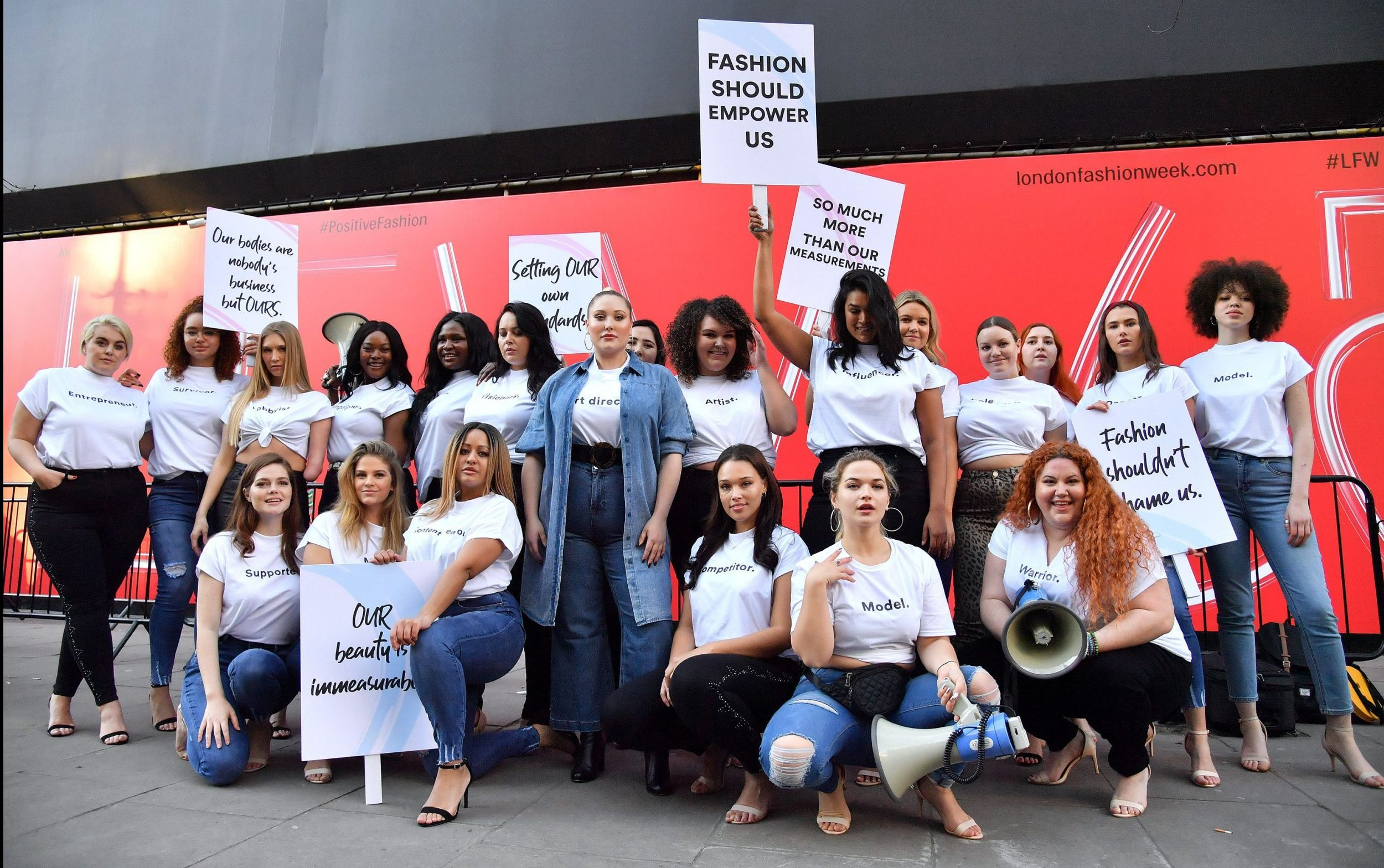 Plus size models call for body inclusivity in protest outside London Fashion Week