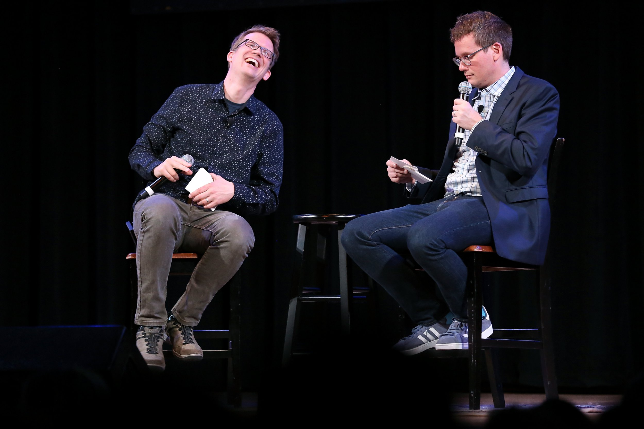 """NEW YORK, NY - SEPTEMBER 25: YouTube personality and author Hank Green (L) speaks on stage with his brother, fellow YouTube personality and author John Green, to discuss his new book """"An Absolutely Remarkable Thing"""" at The Town Hall on September 25, 2018 in New York City. (Photo by Monica Schipper/Getty Images)"""