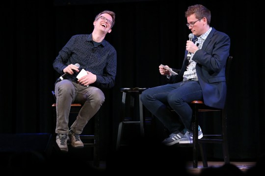 "NEW YORK, NY - SEPTEMBER 25: YouTube personality and author Hank Green (L) speaks on stage with his brother, fellow YouTube personality and author John Green, to discuss his new book ""An Absolutely Remarkable Thing"" at The Town Hall on September 25, 2018 in New York City. (Photo by Monica Schipper/Getty Images)"