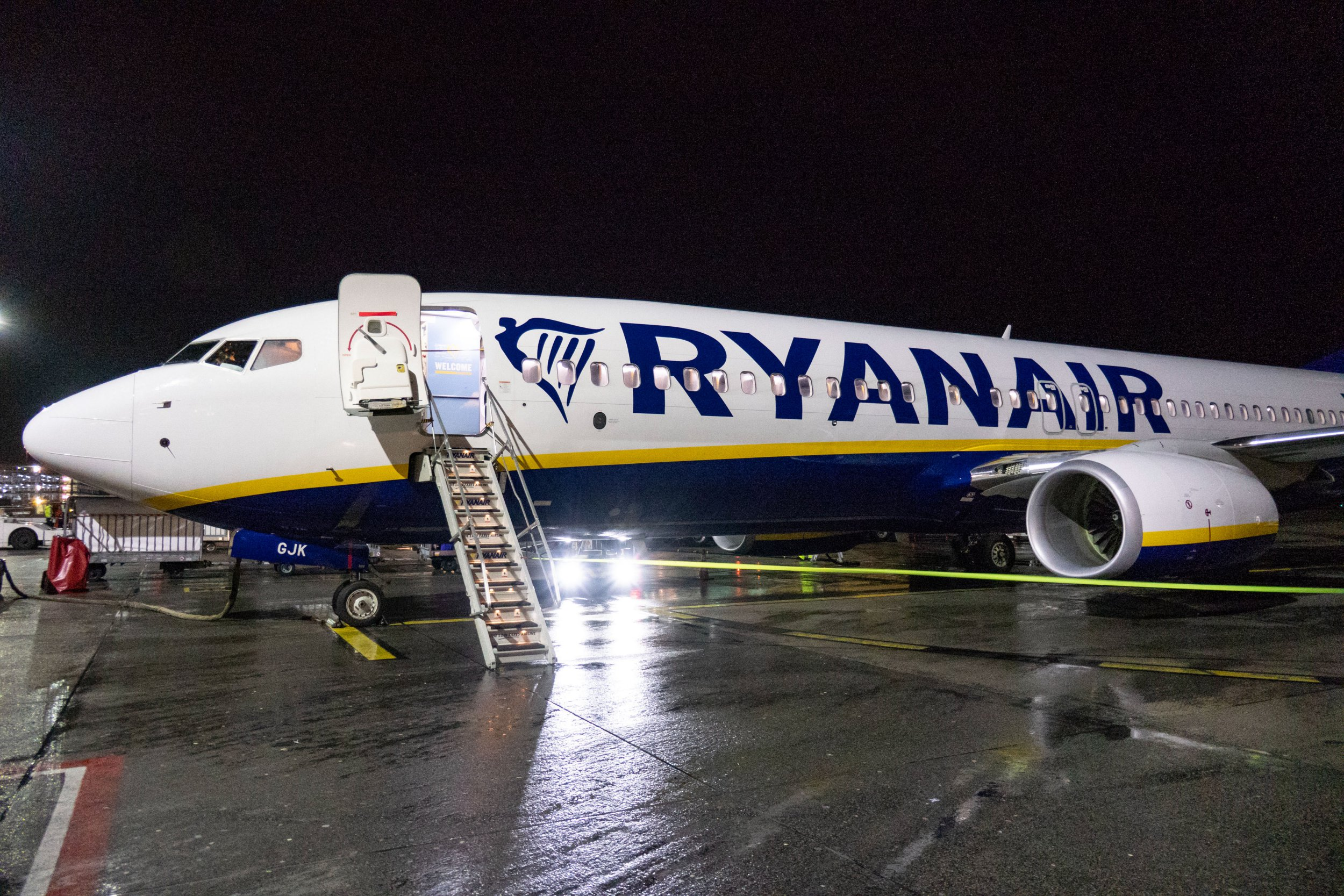 A Ryanair Boeing 737-800 aircraft with registration EI-GJK parked at Eindhoven airport tarmac at night, in the Netherlands. Passengers are disembarking and walking out of the plane. (Photo by Nicolas Economou/NurPhoto via Getty Images)