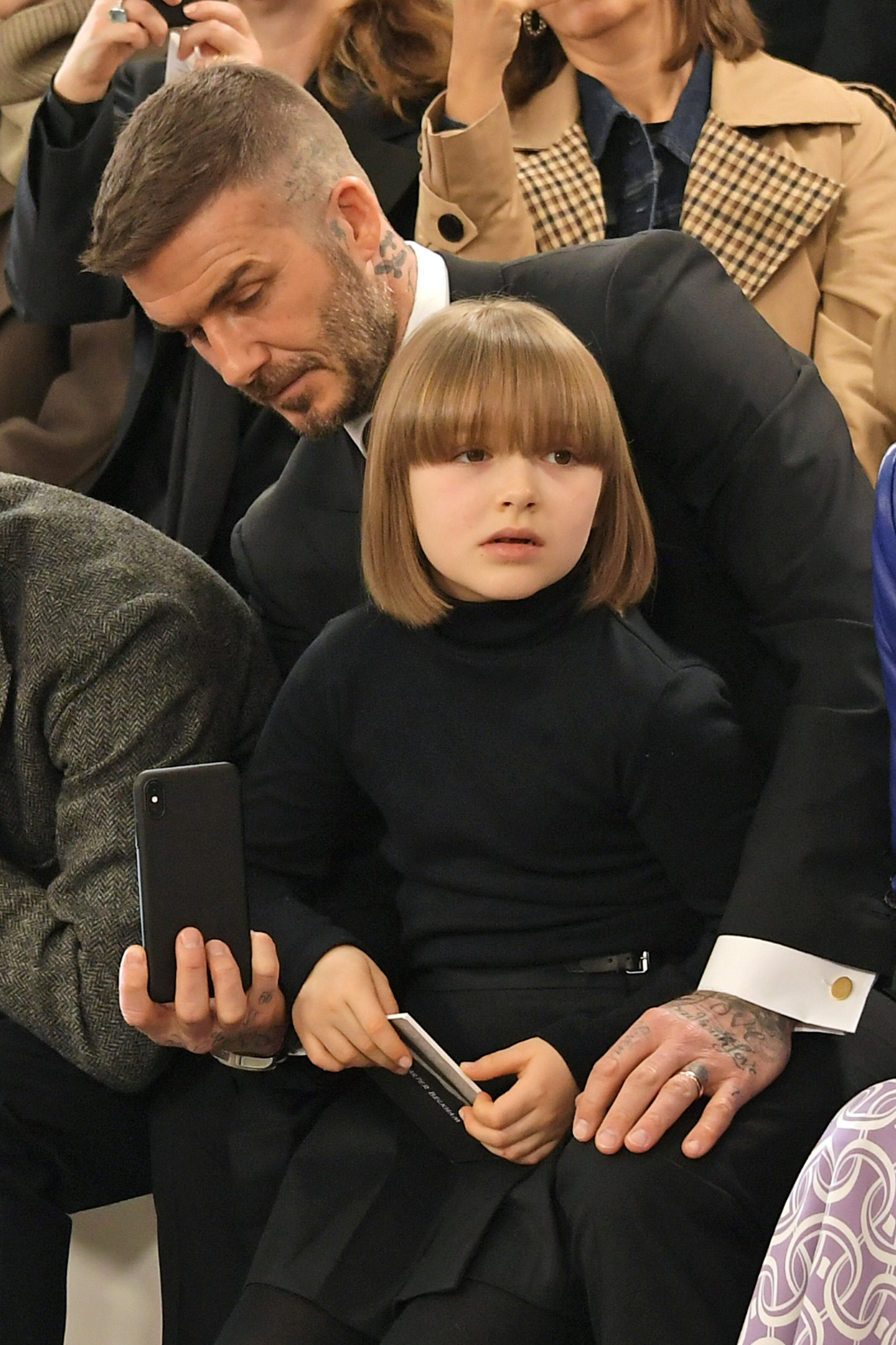 LONDON, ENGLAND - FEBRUARY 17: David Beckham and Harper Beckham attend the Victoria Beckham show during London Fashion Week February 2019 at Tate Britain on February 17, 2019 in London, England. (Photo by David M. Benett/Dave Benett/Getty Images)