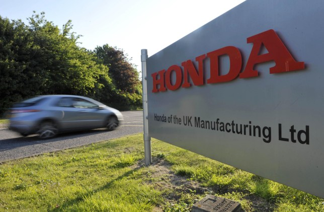 A car drives through the main entrance to the Honda plant in Swindon