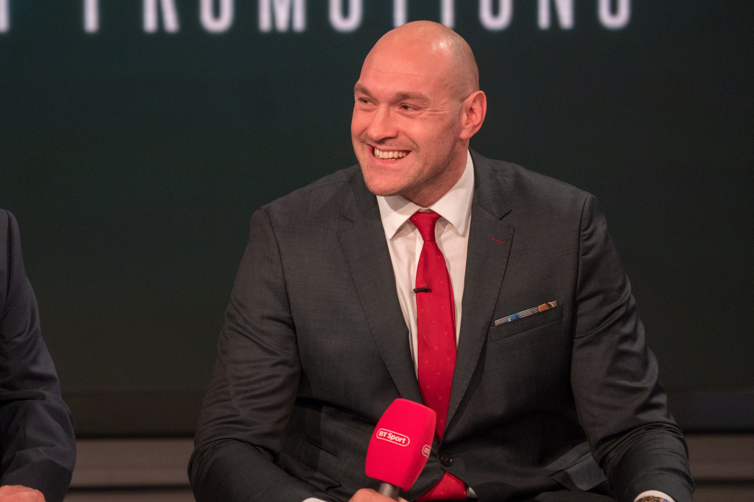 """Handout photo dated 18/02/19 provided by Frank Warren of Tyson Fury during the press conference at BT Sport Studios, London. PRESS ASSOCIATION Photo. Issue date: Monday February 18, 2019. Tyson Fury's proposed rematch with Deontay Wilder has been throw into doubt after the Briton announced a deal with ESPN that makes it the """"exclusive"""" broadcaster of his fights in the United States. See PA story BOXING Fury. Photo credit should read: BT Sport/PA Wire. NOTE TO EDITORS: This handout photo may only be used in for editorial reporting purposes for the contemporaneous illustration of events, things or the people in the image or facts mentioned in the caption. Reuse of the picture may require further permission from the copyright holder."""