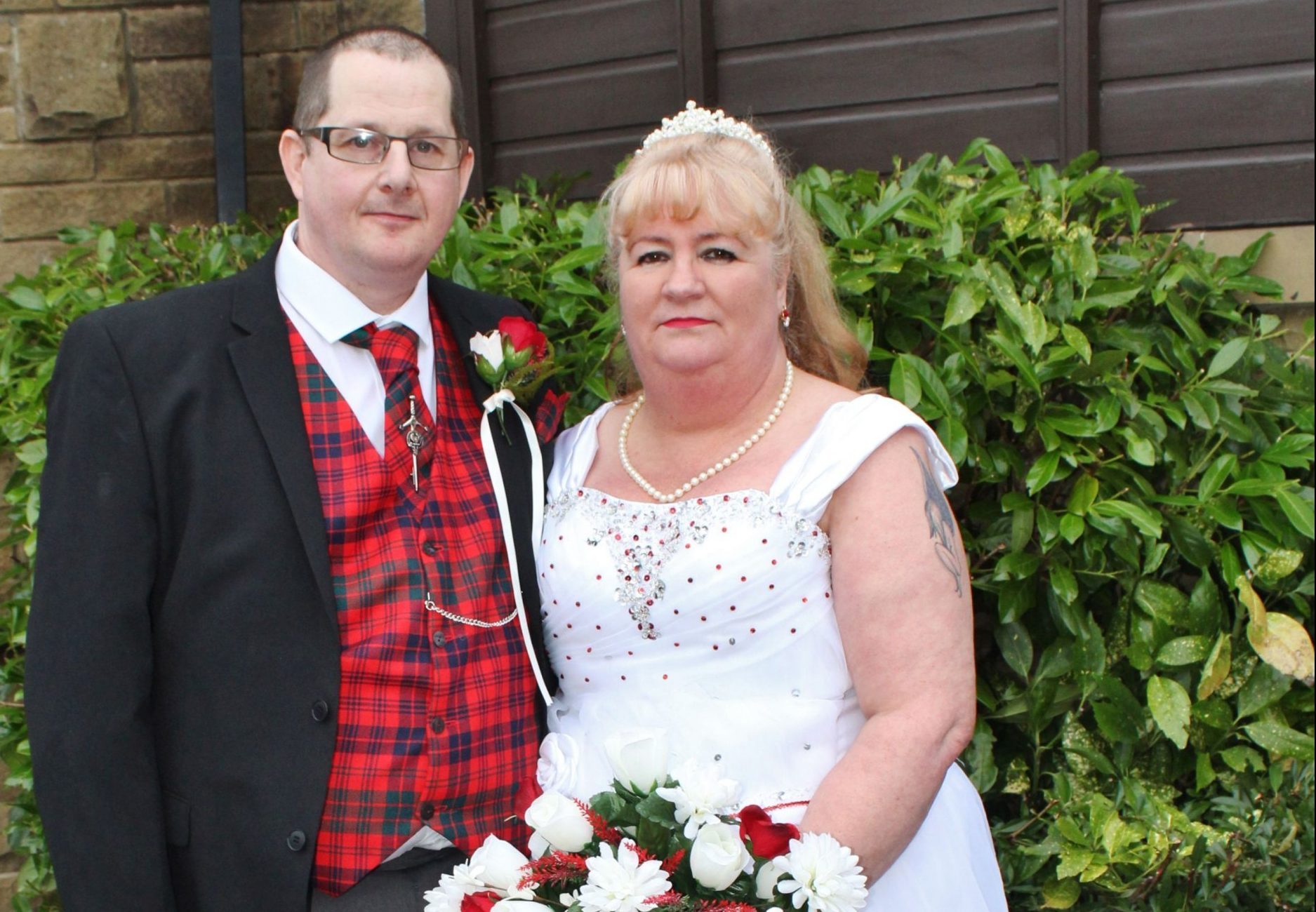 PIC FROM Lauren Batey/ Kennedy News (PICTURED: MARY MCTAGGART, 60, WITH HUSBAND PETER MCTAGGART, 46, ON THEIR WEDDING DAY IN JANUARY 2017) A clumsy hubby claims he accidentally saved his wife's number with one digit wrong - only to end up MARRYING the woman who he sent the misdirected text to. Former security guard Peter Mctaggart, 46, met his current wife Mary, 60, in 2003 after repeatedly texting her number - thinking it was his wife's. After receiving three texts from the stranger, Mary, who was also married to someone else at the time, responded to let Peter know he must have the wrong number. SEE KENNEDY NEWS COPY - 0161 697 4266