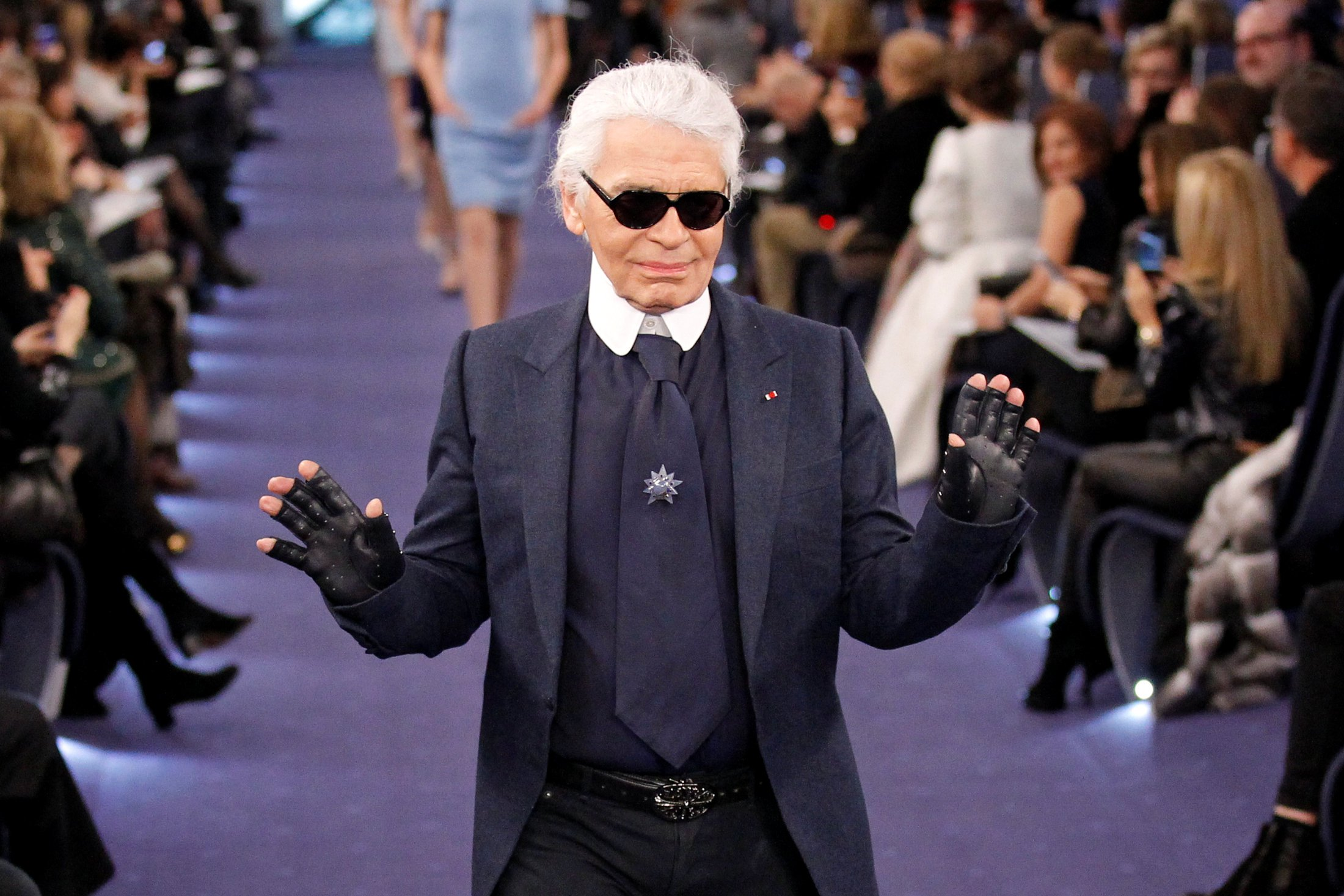 What is Karl Lagerfeld's net worth and how long was he the creative director at Chanel?