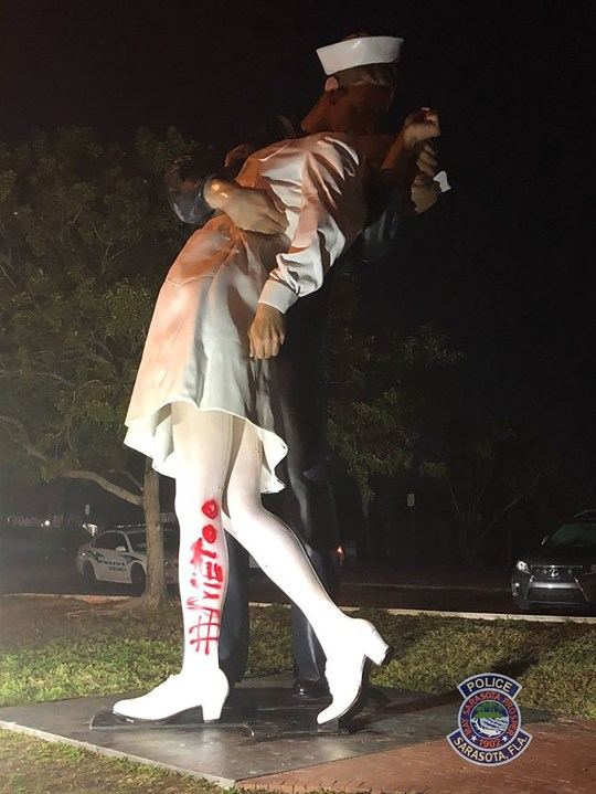 "An 'Unconditional Surrender' statue in Florida has been vandalized with the #MeToo message after the death of an iconic sailor. The statue, which recreates George Mendosa and Greta Zimmer Friedman's famous VJ-Day photo moment from 1945, was tagged Monday in Sarasota with red spray paint that spelled ""#METOO. Cops are hunting for the culprit but have no surveillance footage and the paint has since been removed. It came days after George died at the age 95. The famous black and white snap shows him kissing nurse Greta and it is often romanticized. But George later admitted he'd randomly grabbed the woman and kissed her without consent. Pictured: statue Ref: SPL5065499 190219 NON-EXCLUSIVE Picture by: Sarasota PD/Splash News / SplashNews.com Splash News and Pictures Los Angeles: 310-821-2666 New York: 212-619-2666 London: 0207 644 7656 Milan: 02 4399 8577 photodesk@splashnews.com World Rights,"