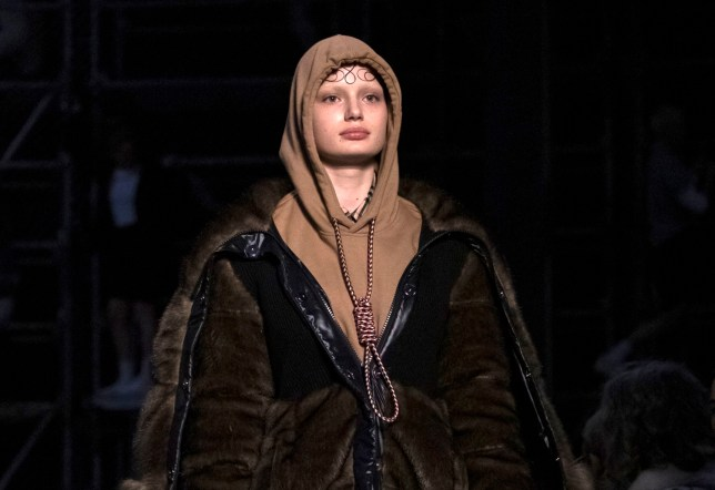This Feb. 17, 2019 photo shows a model wearing a creation by Burberry at the Autumn/Winter 2019 fashion week runway show in London. The chief executive and chief creative officer of luxury powerhouse Burberry have apologized for putting a hoodie with strings tied in the shape of a noose on their London Fashion Week runway. Marco Gobbetti, the brand???s CEO, said in a statement that Burberry is ???deeply sorry for the distress??? the shirt has caused and has removed it from the autumn-winter collection. Riccardo Tisci, Burberry???s creative director, also apologized. He said ???while the design was inspired by a nautical theme, I realize that it was insensitive.??? (Photo by Vianney Le Caer/Invision/AP)