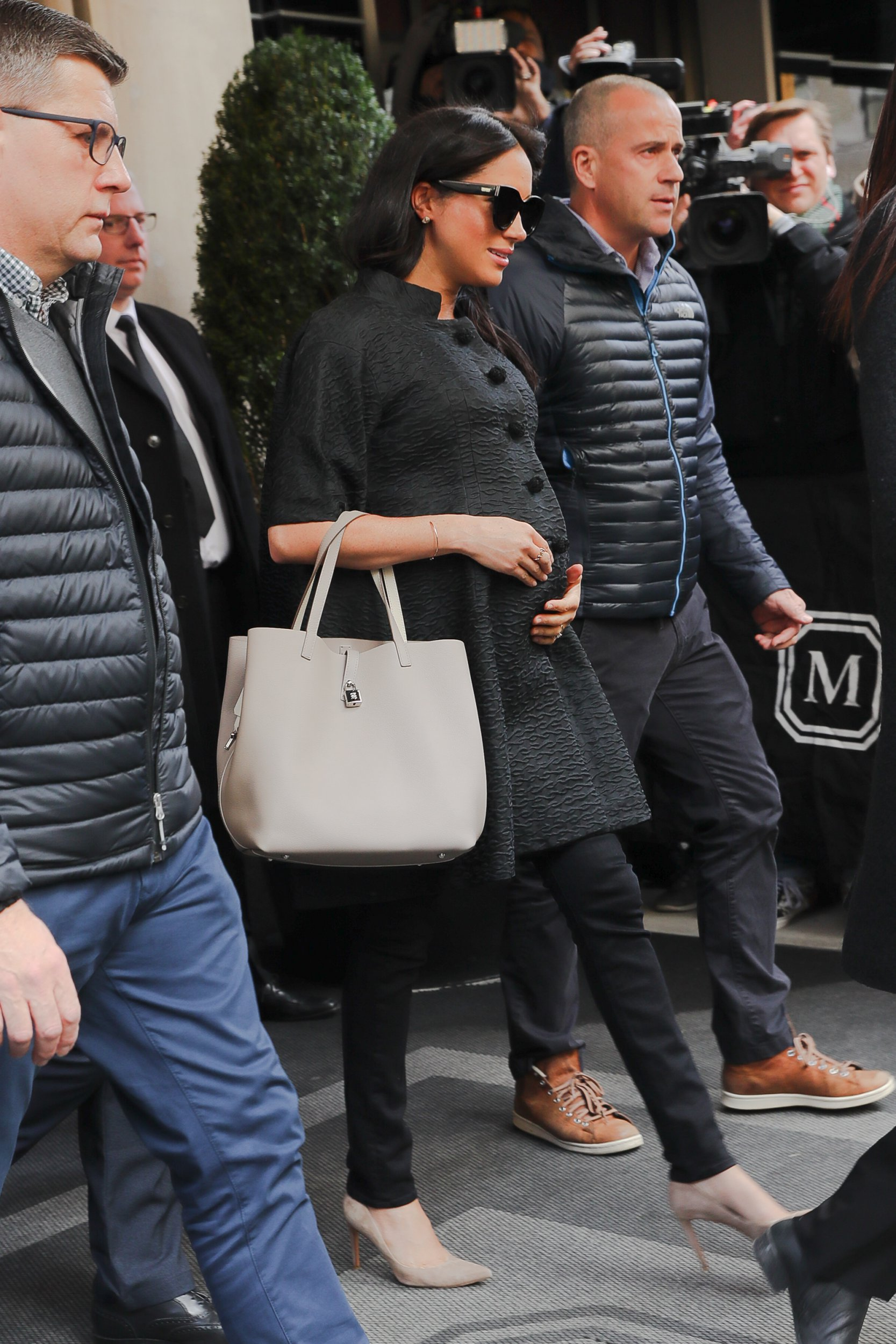 Meghan Markle seen holding her belly while leaving her hotel in NYC. 19 Feb 2019 Pictured: Meghan Markle. Photo credit: MEGA TheMegaAgency.com +1 888 505 6342