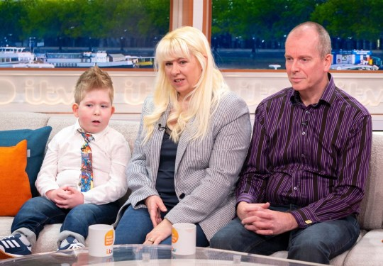 Editorial use only Mandatory Credit: Photo by S Meddle/ITV/REX (10112453ae) Noah Wall and his parents Shelly and Rob 'Good Morning Britain' TV show, London, UK - 20 Feb 2019 NOAH WALL: THE BOY DEFYING ALL ODDS VT: Noah's story Sofa: Noah and his parents Shelly and Rob