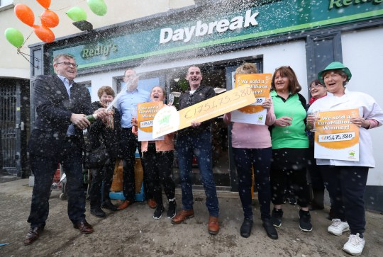 Michale Hayes (left) from the National Lottery sprays champagne as Les Reilly and the staff of Reilly's Daybreak in Naul, Co Dublin, celebrate selling the EuroMillions ?175 million winning lotto ticket. PRESS ASSOCIATION Photo. Picture date: Wednesday February 20, 2019. See PA story LOTTERY Euromillions. Photo credit should read: Niall Carson/PA Wire