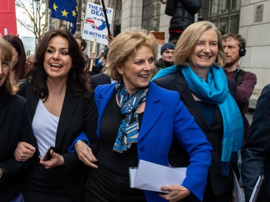 LONDON, ENGLAND - FEBRUARY 20: Former Labour Party MP Joan Ryan (L) links arms with former Conservative MP's Heidi Allen (2L), Anna Soubry (2R) and Sarah Wollaston (R) as they arrive to a press conference to make a statement on their resignations on February 20, 2019 in London, England. Three Conservative MP's have resigned from their party to join The Independent Group following discontent with the leadership. They join seven former Labour Party MP's who left their party earlier in the week. (Photo by Chris J Ratcliffe/Getty Images)