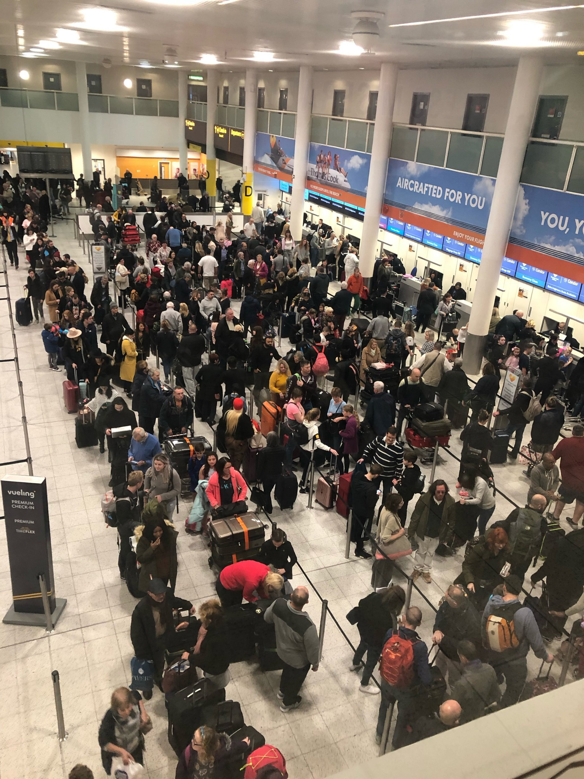"""The drone attack that brought Gatwick to a standstill before Christmas is believed to have been an """"inside job"""", according to Whitehall sources Queues of passengers in the check in area at Gatwick Airport this morning, as the airport remains closed after drones were spotted over the airfield last night and this morning."""