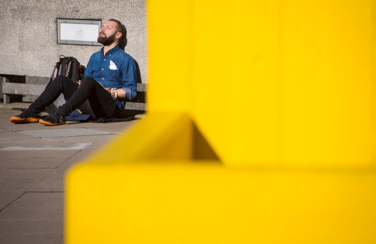 A man enjoys the sun on the South Bank in central London. PRESS ASSOCIATION Photo. Picture date: Sunday February 24, 2019. See PA story WEATHER Warm. Photo credit should read: Dominic Lipinski/PA Wire