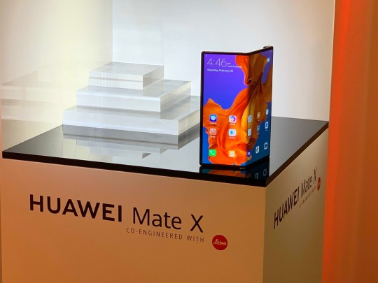 "Undated handout issued by Huawei of the new foldable smartphone, Huawei Mate X, which has a flexible OLED display that covers both the front and back of the device, but can be unfolded to become an eight-inch screen tablet. PRESS ASSOCIATION Photo. Issue date: Sunday February 24, 2019. The Chinese phone make claims the Mate X is the ""world's fastest foldable 5G smartphone"", saying its position as a manufacturer of 5G network infrastructure has given it a ""unique advantage"" as it enabled the company to test the phone on internal 5G networks before release. See PA story TECHNOLOGY Huawei. Photo credit should read: Huawei/PA Wire NOTE TO EDITORS: This handout photo may only be used in for editorial reporting purposes for the contemporaneous illustration of events, things or the people in the image or facts mentioned in the caption. Reuse of the picture may require further permission from the copyright holder."