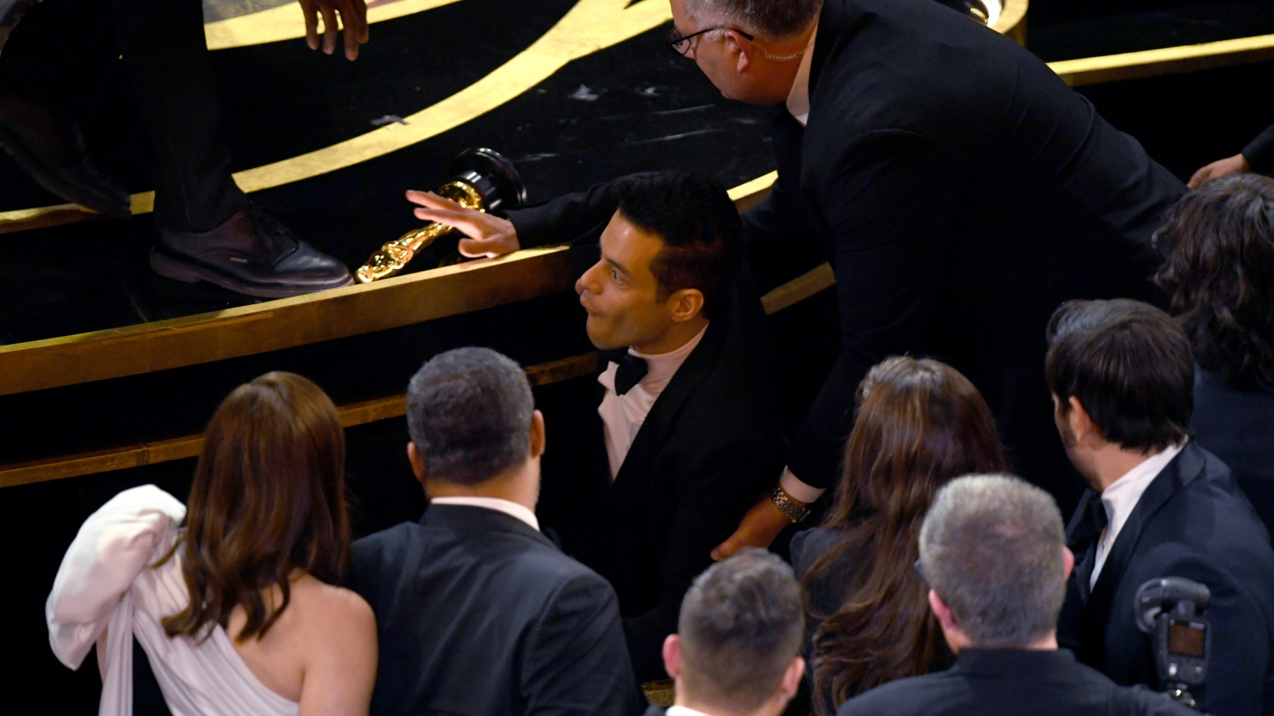 Rami Malek falls off stage and treated by paramedics after winning first Oscar