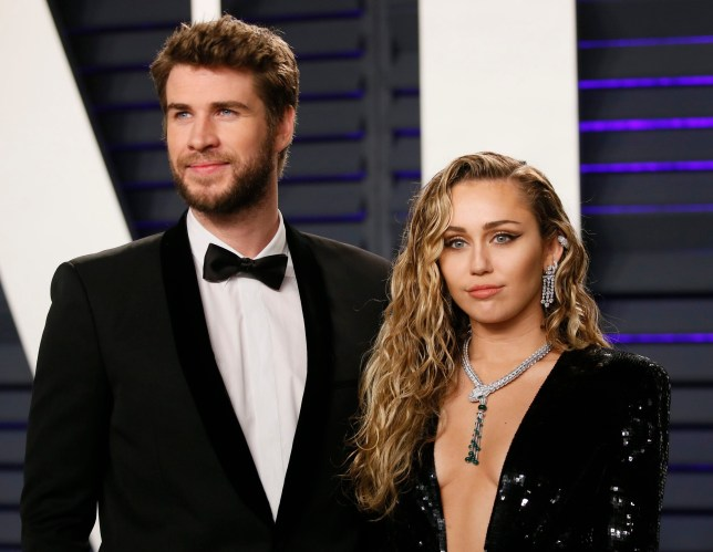91st Academy Awards ??? Vanity Fair ??? Beverly Hills, California, U.S., February 24, 2019 ??? Liam Hemsworth and Miley Cyrus. REUTERS/Danny Moloshok