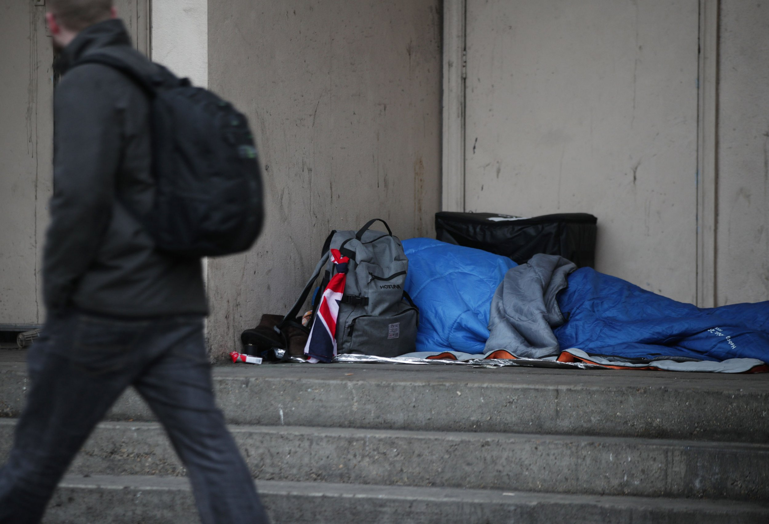 File photo dated 07/02/17 of a person sleeping rough in a doorway. More than nine in 10 deaths of homeless people were in cities and towns in 2017 - with only 26 homeless people dying in rural areas, new data has revealed. PRESS ASSOCIATION Photo. Picture date: Monday February 25, 2019. See PA story POLITICS Homeless. Photo credit should read: Yui Mok/PA Wire