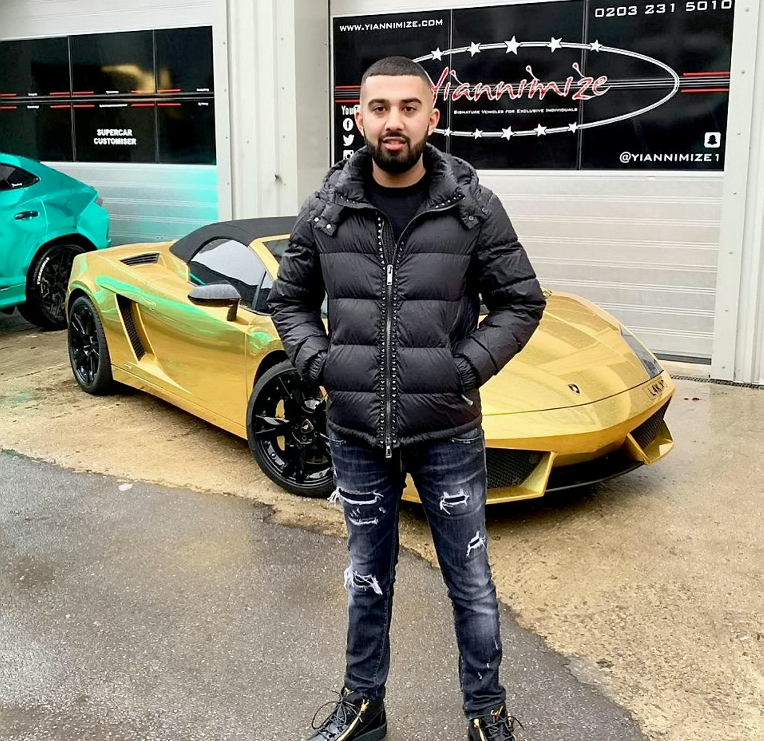 "Lak Sira with his Lamborghini Gallardo which caught fire on the motorway. See SWNS story SWMDlambo; A young businessman was left gutted after his prized ?125,000 Lamborghini Gallardo burst into the flames on the motorway - just an hour after picking it up from the garage. Lak Sira, 22, said he was nearly killed after his ""pride and joy"" supercar went up in smoke as he drove along the M6 with his girlfriend last Friday (22/2). The entrepreneur had been on his way to London when he smelt petrol and was forced to pull over on the hard shoulder near Birmingham. He then jumped from the gold chrome-plated car after hearing a loud bang and watched helplessly as the luxury vehicle was engulfed in flames."
